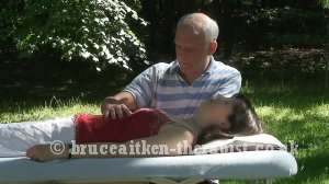 Bruce Aitken giving Craniosacral Therapy